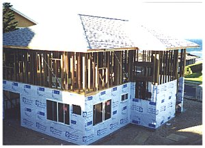 [First floor wrapped & windows in]