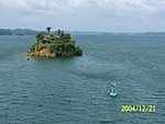 [Small island in Lake Gatun [inundated mountain-top]; stay on the correct side of the bouy!]