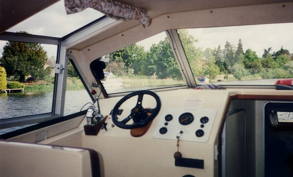 [Her Helm Controls (note that the wheel is on the opposite side from U.S. boats)]