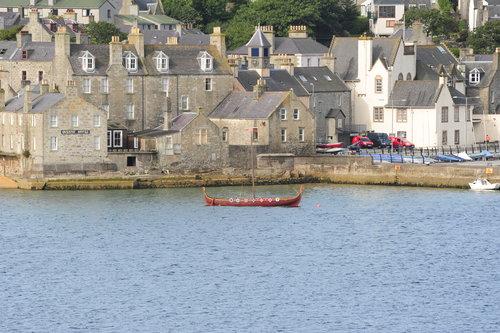 [Viking Boat and Harbor Buildings]