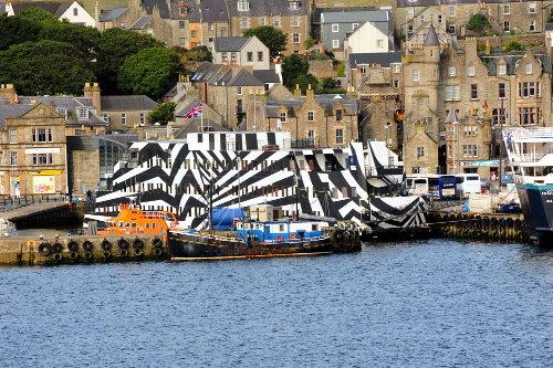 ['Dazzle' Building, Lerwick, Scotland (floating apartment building painted in WWI dazzle paint scheme)]