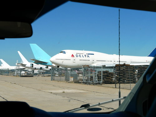 [View through the windshield of the tour van [this is one of several 747's being stored here.]]